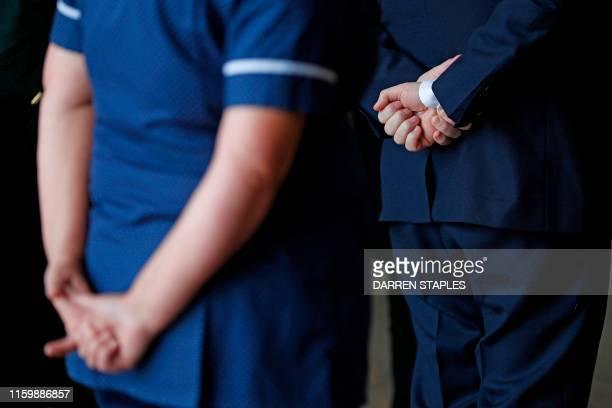 Britain's Prime Minister Boris Johnson during a visit to Pilgrim Hospital in Boston eastern England on August 5 2019 Prime Minister Boris Johnson...