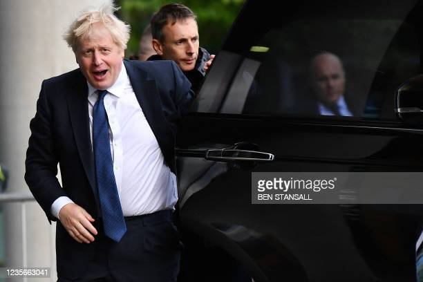 Britain's Prime Minister Boris Johnson gestures as he arrives for an appearance on the Andrew Marr Show ahead of the first day of the annual...