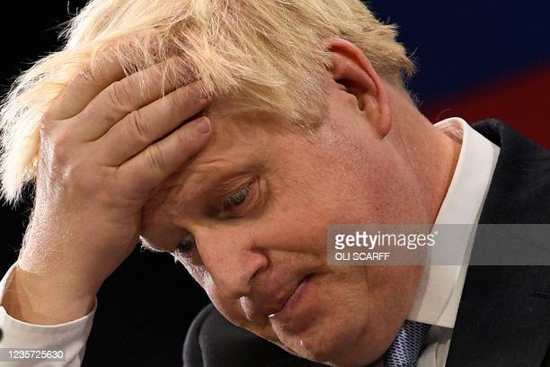Britain's Prime Minister Boris Johnson gestures as he delivers his keynote speech on the final day of the annual Conservative Party Conference at the...