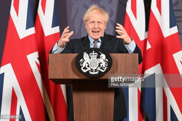Britain's Prime Minister Boris Johnson gestures as he holds a remote press conference to update the nation on the post-Brexit trade agreement, inside...