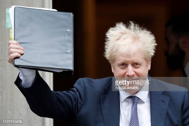 TOPSHOT Britain's Prime Minister Boris Johnson gestures as he leaves from 10 Downing Street in central London on October 23 before heading to the...
