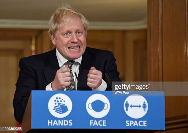 Britain's Prime Minister Boris Johnson gestures as he speaks during a press conference in 10 Downing Street on October 31, 2020 in London, England....