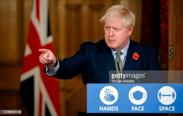 Britain's Prime Minister Boris Johnson gestures as he speaks during a virtual press conference on the coronavirus pandemic in the UK inside 10...