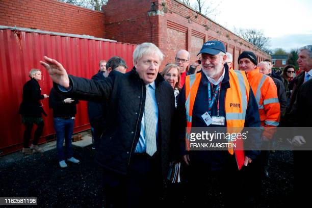 Britain's Prime Minister Boris Johnson gestures as he talks with Fleetwood Town councillor Brian Crawford during a General Election campaign trail...