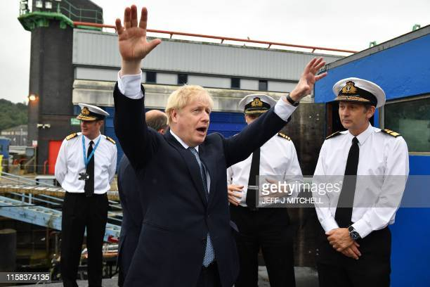 Britain's Prime Minister Boris Johnson gestures as he visits Vanguardclass submarine HMS Vengeance during a visit to Faslane Naval base north of...
