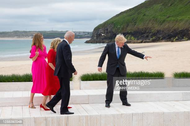 Britain's Prime Minister Boris Johnson gestures as his wife Carrie Johnson , US President Joe Biden and US First Lady Jill Biden arrive for an...