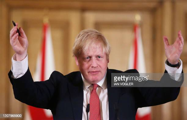 Britain's Prime Minister Boris Johnson gestures during a news conference to give a daily update on the government's response to the novel coronavirus...