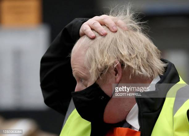 Britain's Prime Minister Boris Johnson gestures during a visit to a DIY shop in Middlesbrough, north Yorkshire on April 1 during a visit to Teesside...