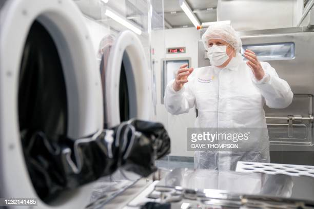Britain's Prime Minister Boris Johnson gestures during a visit to AstraZeneca in Macclesfield, Chesire, northwest England on April 6 to learn more...