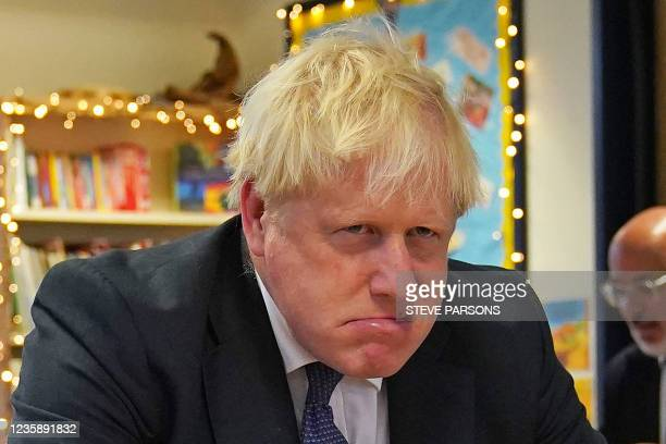 Britain's Prime Minister Boris Johnson gestures during a visit to Westbury-On-Trym Church of England Academy in Bristol on October 15 ahead of...
