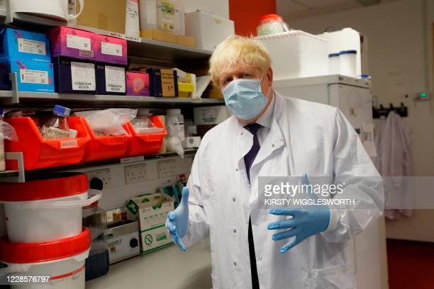 Britain's Prime Minister Boris Johnson gestures during a visit to the Jenner Institute in Oxford central England on September 18 where the Prime...
