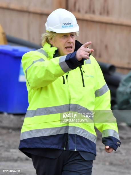 Britain's Prime Minister Boris Johnson gestures during his visit to the Speller Metcalfe's building site at the The Dudley Institute of Technology in...