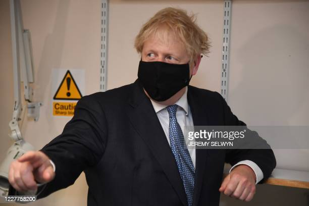 Britain's Prime Minister Boris Johnson gestures during his visit to the Tollgate Medical Centre in Becton, east London on July 24, 2020..