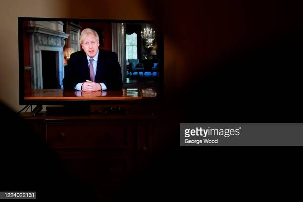 Britain's Prime Minister Boris Johnson gives a televised message to the nation to announce a new alert system and a possible timeline for the gradual...