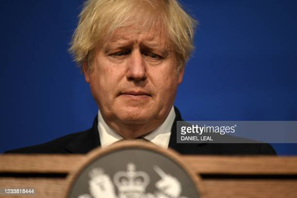 Britain's Prime Minister Boris Johnson gives an update on relaxing restrictions imposed on the country during the coronavirus covid-19 pandemic at a...