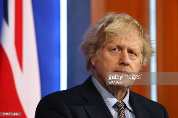 Britain's Prime Minister, Boris Johnson gives an update on the coronavirus Covid-19 pandemic during a virtual press conference in the new £2.6million...
