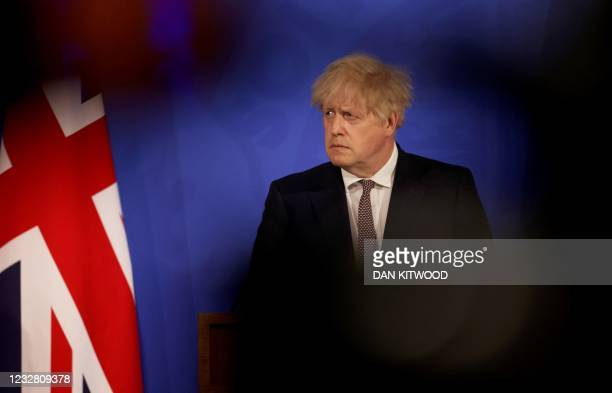 Britain's Prime Minister Boris Johnson gives an update on the coronavirus Covid-19 pandemic during a virtual press conference inside the Downing...