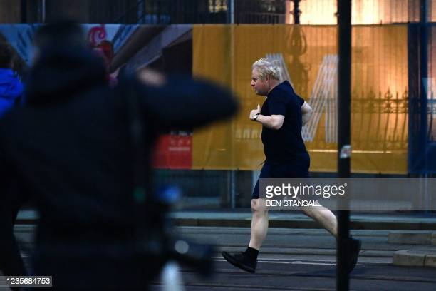 Britain's Prime Minister Boris Johnson goes for a run before the second day of the annual Conservative Party Conference being held at the Manchester...