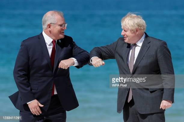 Britain's Prime Minister Boris Johnson greets Australia's Prime Minister Scott Morrison during an official welcome at the G7 summit in Carbis Bay on...