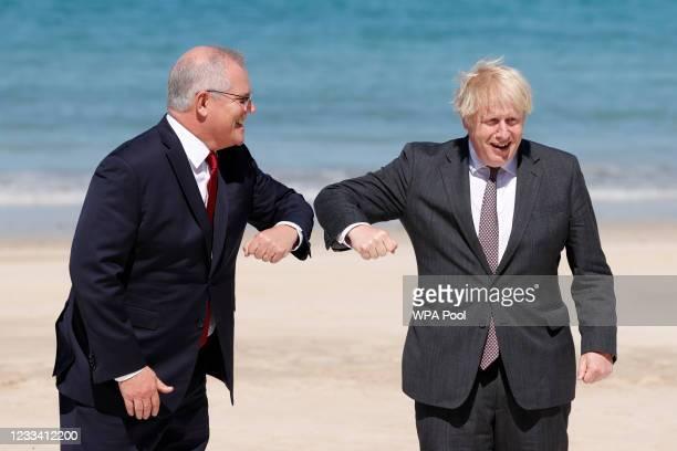 Britain's Prime Minister Boris Johnson greets Australia's Prime Minister Scott Morrison at the G7 summit in Carbis Bay on June 12, 2021 in Carbis...