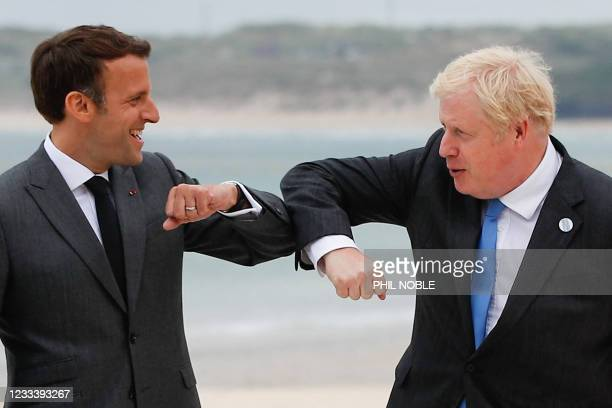 Britain's Prime Minister Boris Johnson greets France's President Emmanuel Macron during the G7 summit in Carbis Bay, Cornwall, south-west England on...