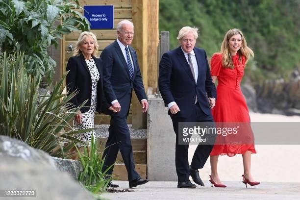 Britain's Prime Minister Boris Johnson, his wife Carrie Johnson and U.S. President Joe Biden with First Lady Jill Bidenn walk outside Carbis Bay...