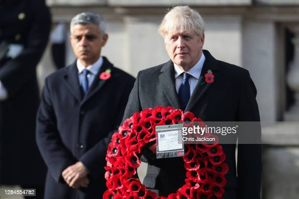 Britain's Prime Minister Boris Johnson holds a wreath during the National Service of Remembrance at The Cenotaph on November 08, 2020 in London,...