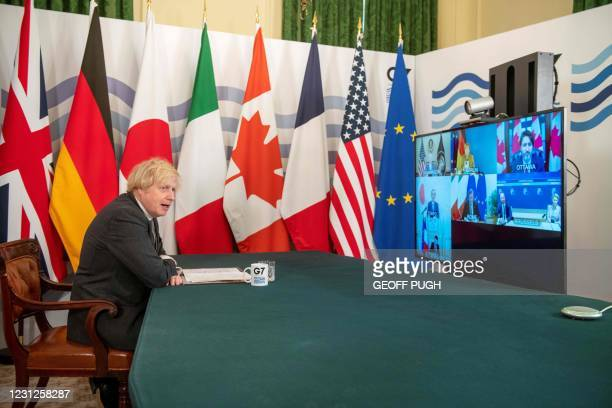 Britain's Prime Minister Boris Johnson hosts a virtual meeting of G7 leaders in the Cabinet Room at Downing Street in London on February 19, 2021. -...