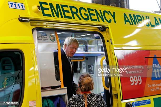 Britain's Prime Minister Boris Johnson inspects an ambulance during a visit to Pilgrim Hospital in Boston eastern England on August 5 2019 Prime...