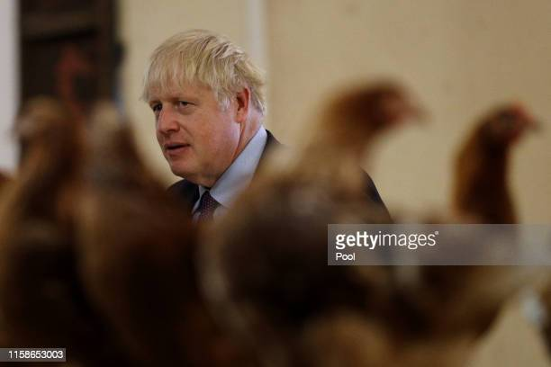 Britain's Prime Minister Boris Johnson inspects the poultry during his visit to rally support for his farming plans postBrexit at Shervington Farm St...