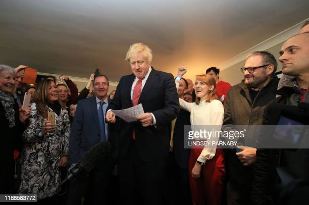 Britain's Prime Minister Boris Johnson is cheered by supporters on a visit to meet newly elected Conservative party MP for Sedgefield, Paul Howell at...