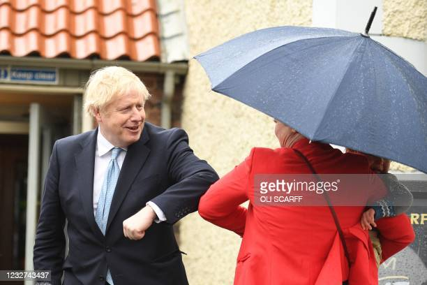Britain's Prime Minister Boris Johnson is greeted by a supporter Kelly Whitfield and her son Jonny as he leaves Jacksons Wharf pub in Hartlepool,...