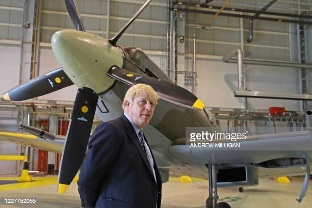 Britain's Prime Minister Boris Johnson is seen alongside a Spitfire at RAF Lossiemouth, north-east Scotland, on July 23, 2020 during a visit to the...