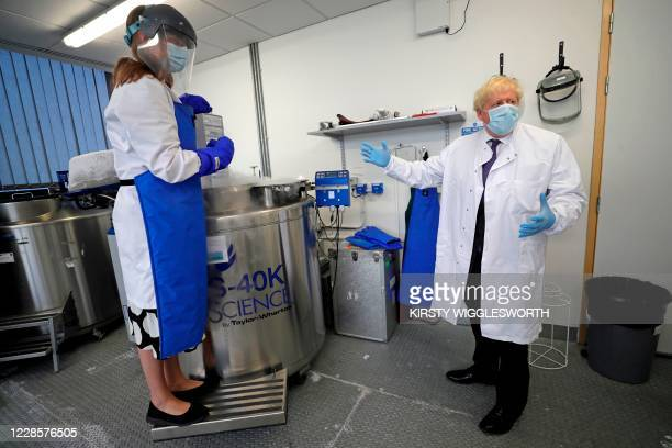 Britain's Prime Minister Boris Johnson is shown samples stored in liquid nitrogen by Professor Kate Ewer, Senior Immunologist, during a visit to the...