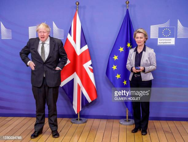 Britain's Prime Minister Boris Johnson is welcomed by European Commission President Ursula von der Leyen in the Berlaymont building at the EU...