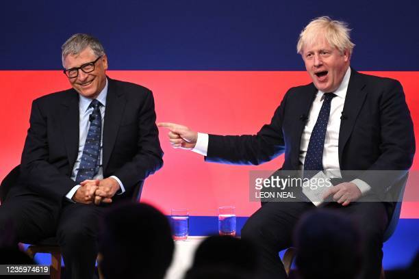 Britain's Prime Minister Boris Johnson jokes with Microsoft founder-turned-philanthropist Bill Gates during a discussion on stage during the Global...