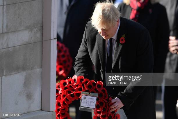 Britain's Prime Minister Boris Johnson lays a wreath at the Cenotaph during the Remembrance Sunday ceremony at the Cenotaph on Whitehall in central...
