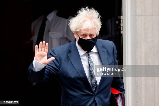 Britain's Prime Minister Boris Johnson leaves 10 Downing Street in central London on December 16 to take part in the weekly session of Prime Minister...