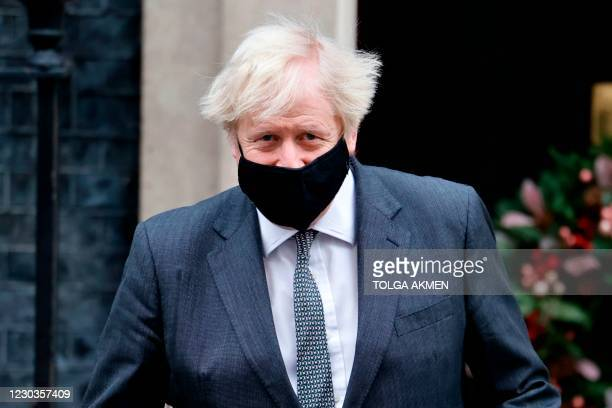 Britain's Prime Minister Boris Johnson leaves 10 Downing Street in London after lunch on December 30, 2020. - Members of the British parliament are...