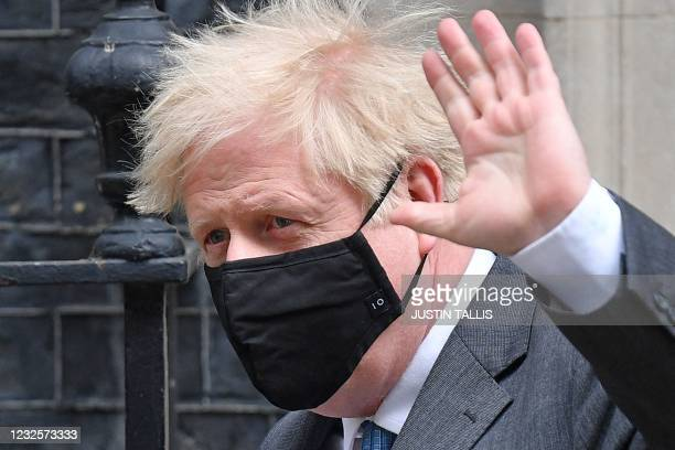 Britain's Prime Minister Boris Johnson leaves 10 Downing Street in central London on April 28 to take part in the weekly session of Prime Minister's...