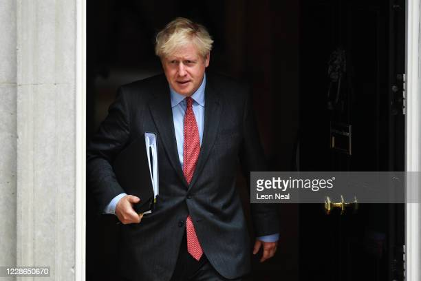 Britain's Prime Minister Boris Johnson leaves 10 Downing Street on his way to the Houses of Parliament on September 22, 2020 in London, England....
