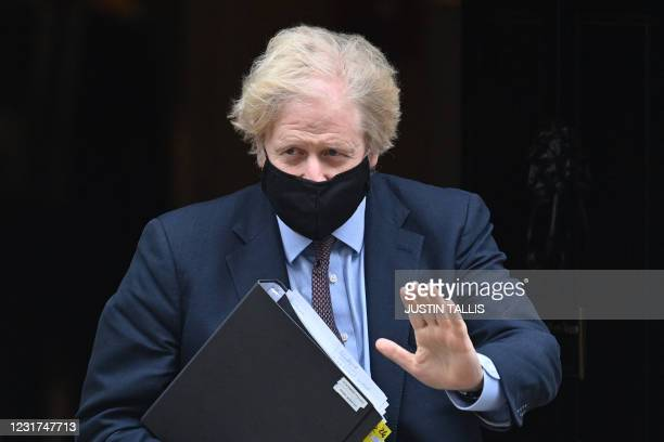 Britain's Prime Minister Boris Johnson leaves 10 Downing street to deliver a statement to Parliament on the government's Integrated Review in London...