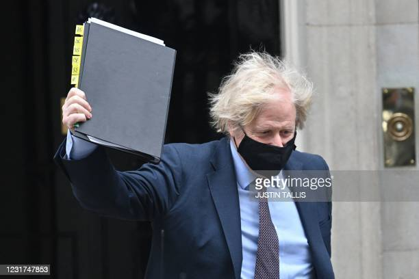 Britain's Prime Minister Boris Johnson leaves 10 Downing street to deliver a statement to Parliament on the government's Integrated Review on March...