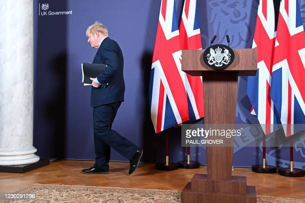 Britain's Prime Minister Boris Johnson leaves after holding a remote press conference to update the nation on the post-Brexit trade agreement, inside...