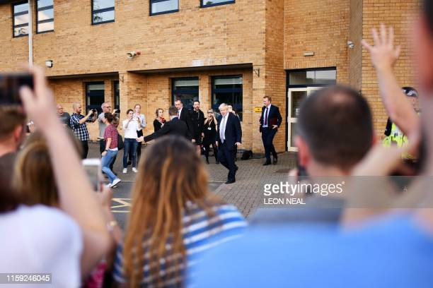 Britain's Prime Minister Boris Johnson leaves after meeting with rescue crews and local residents at ChapelenLefrith High School as work continued at...