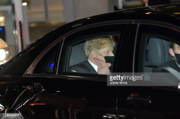 Britain's Prime Minister Boris Johnson leaves in a car after a post-Brexit talks' working dinner at the EU headquarters on December 9, 2020 in...