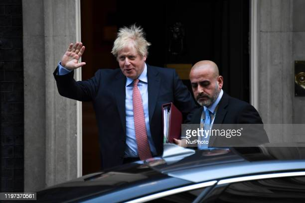 Britain's Prime Minister Boris Johnson leaves number 10 Downing Street in central London on January 29 to take part in the Prime Minister Question...