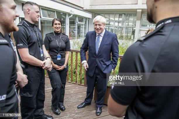 Britain's Prime Minister Boris Johnson meets graduates of West Midlands Police training centre in Birmingham central England on July 26 2019 Johnson...