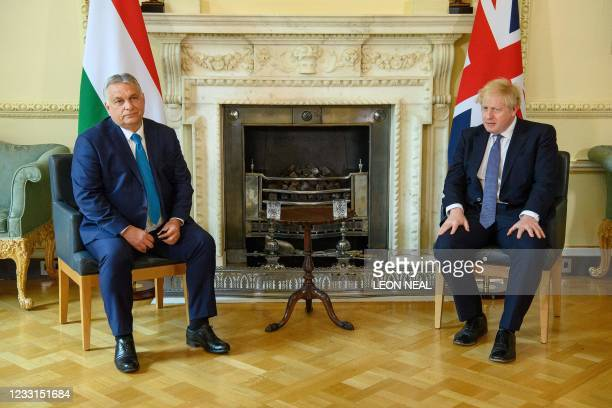 Britain's Prime Minister Boris Johnson meets Hungarian Prime Minister Viktor Orban at Downing Street on May 28, 2021 in London.