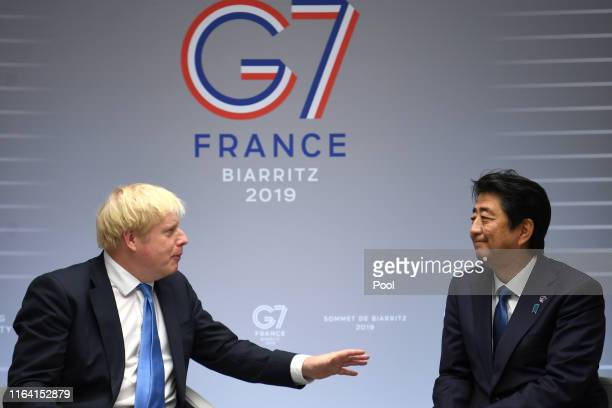 Britain's Prime Minister Boris Johnson meets Japanese Prime Minister Shinzo Abe for their bilateral talks during the G7 Summit on August 26 2019 in...